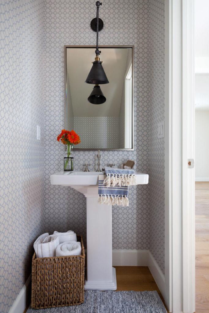 Pattern wallpaper powder room pedestal sink library light designed by Kate Lester Interiors