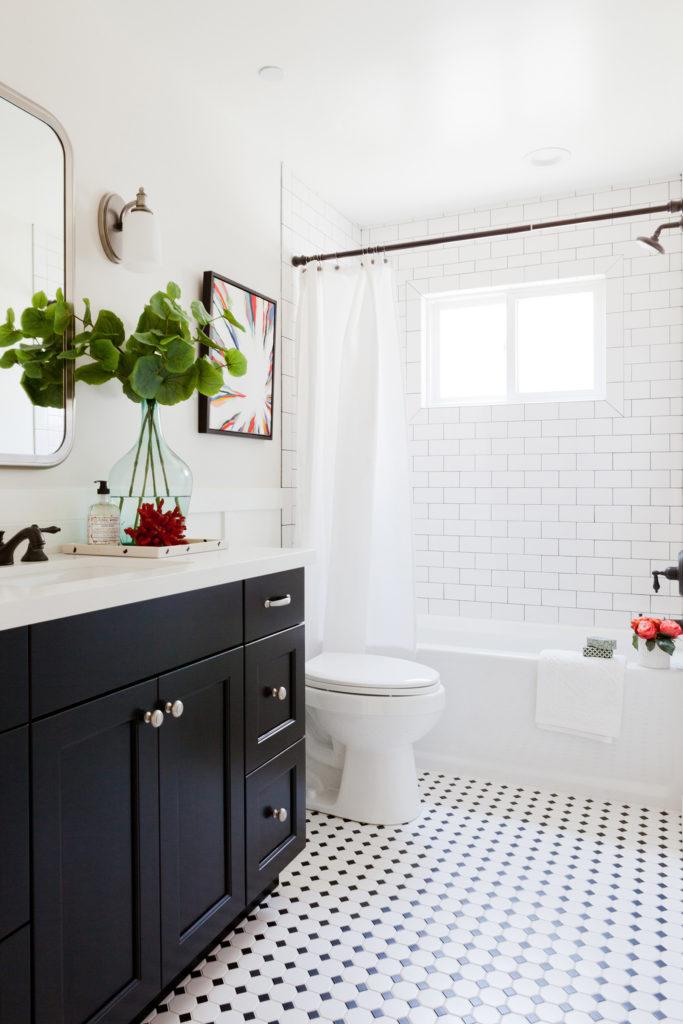 Black and white bathroom black cabinet vintage pattern tile designed by Kate Lester Interiors