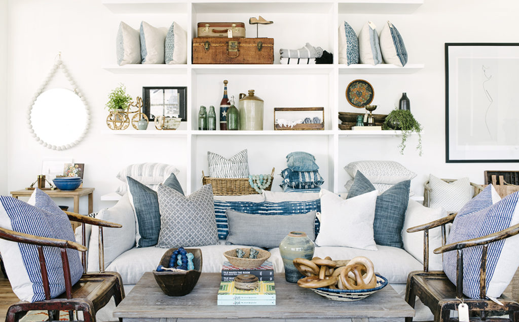 store and shop living room white sofa and built in bookcase vintage chairs designed by Kate Lester Interiors